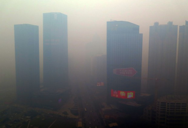 TOPSHOTS This picture taken on November 8, 2015 shows a residential block covered in smog in Shenyang, China's Liaoning province.  A swathe of China was blanketed with dangerous acrid smog after levels of the most dangerous particulates reached almost 50 times World Health Organization maximums.         CHINA OUT AFP PHOTOSTR/AFP/Getty Images